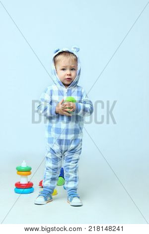 Cute Little Baby Boy Playing Toys.People, children, childhood concept - Cute little baby boy wearing on sleepwear standing.