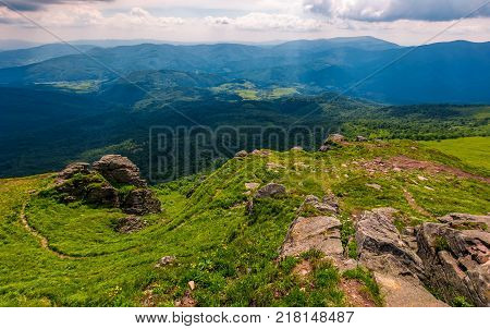 footpath among huge rocks on the edge of a hill. beautiful valley view from the top