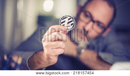 Litecoin Cryptocurrency In Hand Of A Casual Businessman