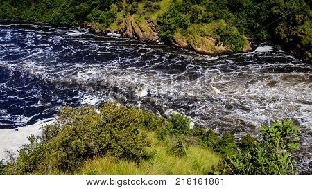 The Nile after the Murchison Falls, also known as Kabalega Falls, is a waterfall between Lake Kyoga and Lake Albert on the White Nile River in Uganda.