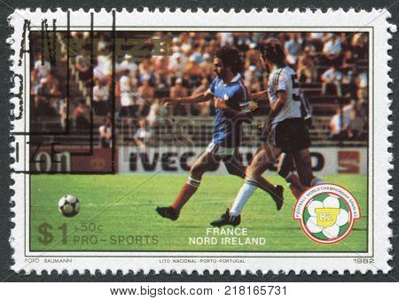 BELIZE-CIRCA 1982: A stamp printed in the Belize is dedicated to FIFA World Cup 1982 in Spain shows a match between France - Northern Ireland circa 1982