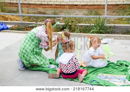 village Poltavskaja, Russia - September 8, 2017: Leisure of preschool children. Animators at a children's party. Acting and developing games for children