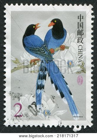 PEOPLE'S REPUBLIC OF CHINA - CIRCA 2002: A stamp printed in the China shows a bird Urocissa caerulea circa 2002