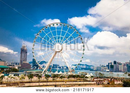 HONG KONG -APR 4, 2016: Ferris Wheel in Hong Kong at sanny day n Apr 4, 2016. The Hong Kong Observation Wheel is located in Central, Hong Kong.