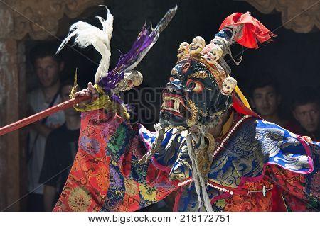 Tibetan lama performs the ritual Dance Mask in the Buddhist monastery of Karsh, Zanskar, Himalayas.