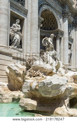 ROME, ITALY - JUNE 23, 2017: Tourists visiting Trevi Fountain (Fontana di Trevi) in city of Rome, Italy