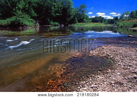 Swift current of the Kishwaukee River in Boone County Illinois