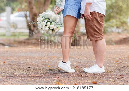 close up couple married in park love concept