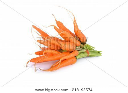 fresh baby carrot with stem on white background