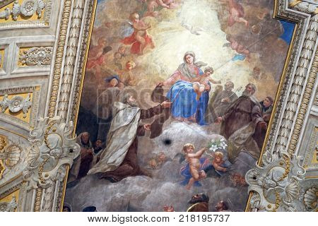 ROME, ITALY - SEPTEMBER 02: Virgin Mary with baby Jesus and Carmelite saints, ceiling of Santa Maria de Monte Carmelo Church in Trastevere, Rome, Italy on September 02, 2016.