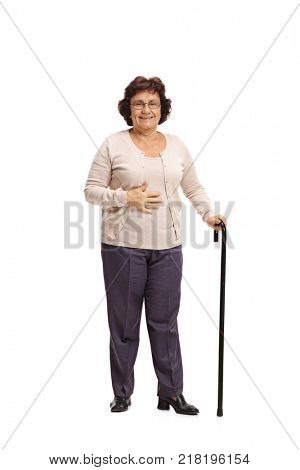 Full length portrait of an elderly woman with a walking cane isolated on white background