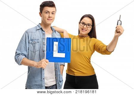 Teenagers with an L-sign and a car key isolated on white background