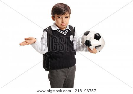 Disappointed little schoolboy holding a deflated football isolated on white background