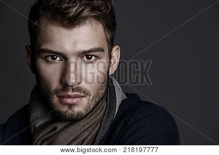 Close-up portrait of a handsome young man with brave manly face. Male beauty, cosmetics.