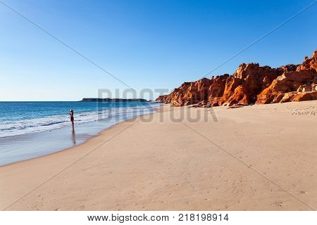 A girl stands at Cape Leveque. Cape Leveque is the northernmost tip of the Dampier Peninsula in the Kimberley region of Western Australia. Cape Leveque is 240 kilometres north of Broome.