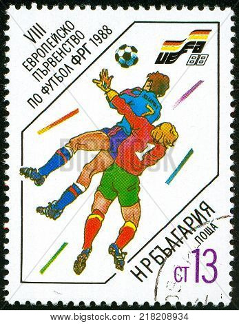 UKRAINE - circa 2017: A postage stamp printed in Bulgaria shows Head Duel Series European Football Championship circa 1988