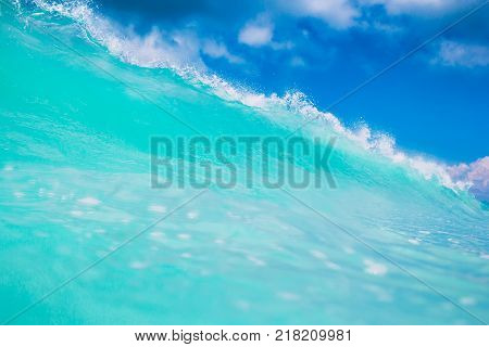Blue or turquoise ocean wave. Clear wave in tropics and blue sky