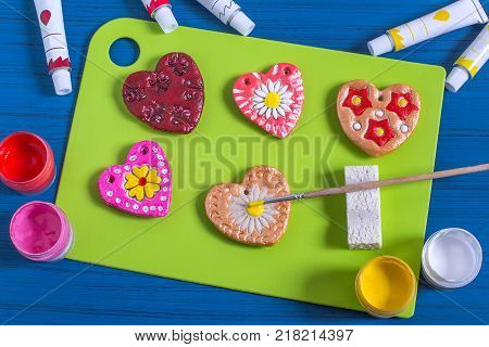 Making souvenirs from salty dough for Valentine's Day with your own hands. Art project handmade. DIY. Step-by-step photo instructions. Step 5. Decoration hearts with prints from culinary plungers