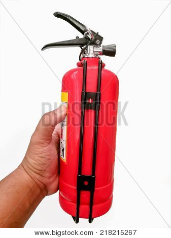 Male hands hold a fire extinguisher by pressing the trigger fire extinguisher. Isolated on white