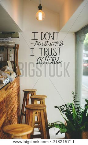 I dont trust words, I trust actions inspirational quote on a wall