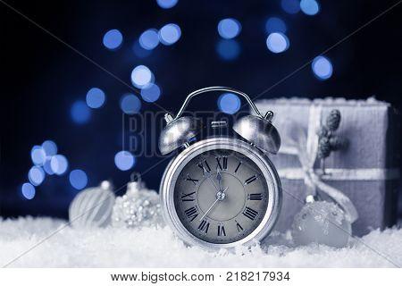 Nearly twelve o'clock New Year dark festive background copy space
