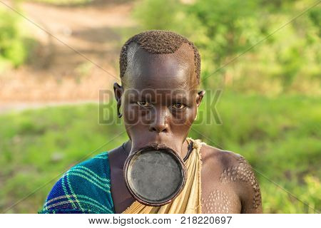 OMO VALLEY, ETHIOPIA - MAY 3, 2015 : Woman from the African tribe Surma with big lip plate.
