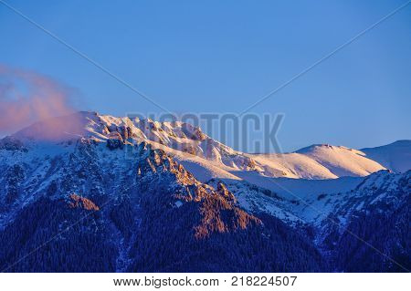 beautiful winter landscape with the Bucegi Mountains in Romania