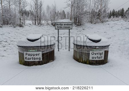 snowy dustbins at a rest area near Filipstad in Sweden