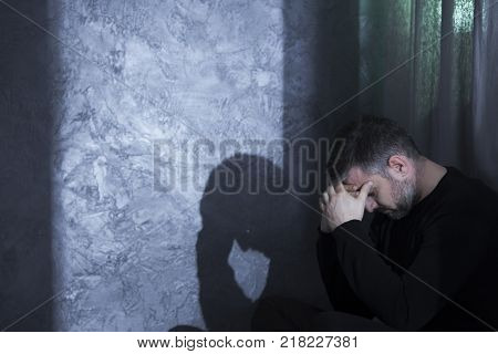 Sad Middle-aged Man Smoking Cigarette