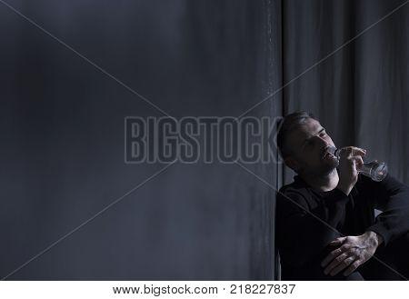 Divorced Man Drowning His Sorrows