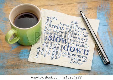 slow down and relax - reducing stress tips in a form of a word cloud on a napkin with a cup of coffee