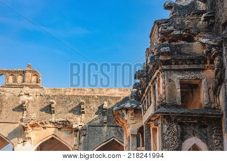 Details of the ancient ruins of Queen's Bath that are located in the southeast of the Royal Enclosure, Hampi, Karnataka, India.