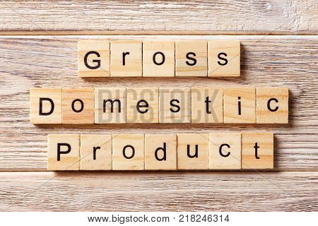 gross domestic product word written on wood block. GDP text on table concept.