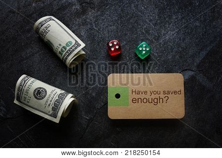 Have You Saved Enough text on a paper tag with dice and cash