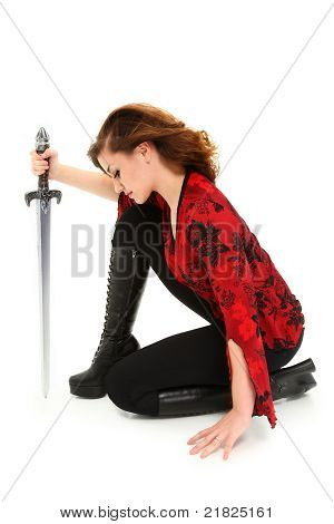 Teen Girl With Sword Over White Background With Clipping Path