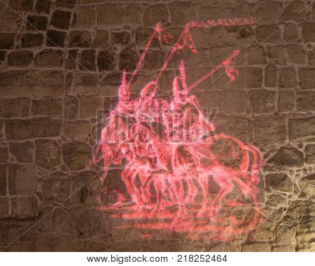 Acre Israel November 03 2017 : Light projecting tells about the time of the Turkish conquest on the inner wall of the hall in the ruins of the fortress in the old city of Acre in Israel