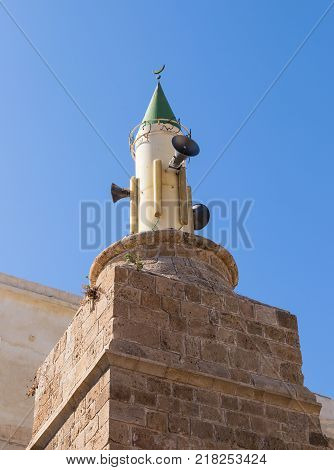 A minaret on the Al-Muallaq Mosque in the fortress in the old city of Acre in Israel