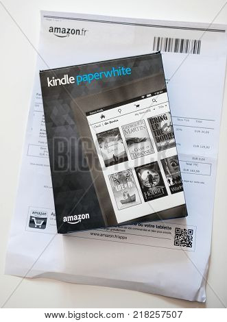 Amazon Kindle Paperwhite And Leather Protection Cover On The White A4 Invoice