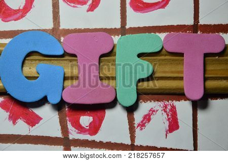 word gift on an   abstract colored  background