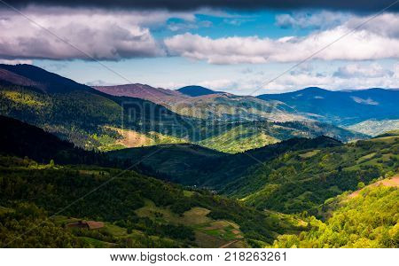 rolling forested hills on a cloudy springtime day. beautiful scenery of mountainous countryside