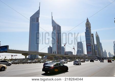 DUBAI UAE - NOVEMBER 19: The view on Emirates Towers and Sheikh Zayed road on November 19 2017. The Emirates Towers complex is set in over 570000 m2