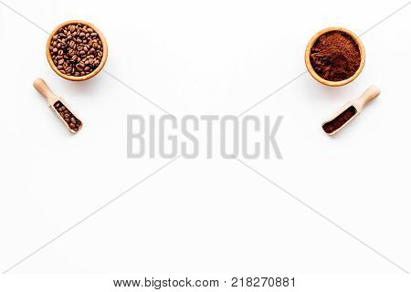 Coffee concept. Beans and grounded coffee in bowls on white background top view.