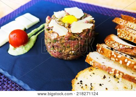 tasty Steak tartare (Raw beef) - classic steak tartare on white plate