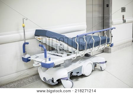 Rolling Hospital bed in a Hospital Hallway