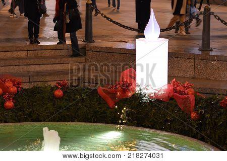 Advent in Zagreb, Croatia: Burning Advent candle at Mandusevac fountain