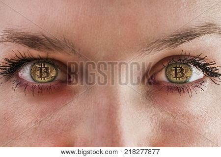 Bitcoin. Eyes of a person with the logo bitcoin. The place of the pupils in the human bitcoin