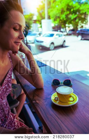 The Girl Is Resting In A Cafe.