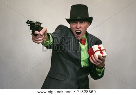 Christmas present box in the hand of secret detective agent or thief isolated on white. Secret service. The spy concept.
