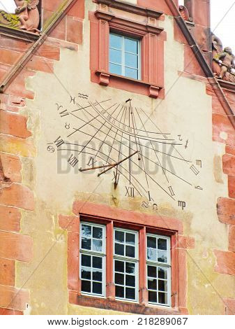 The detail of sundial painted on facade of renaissance house i poster