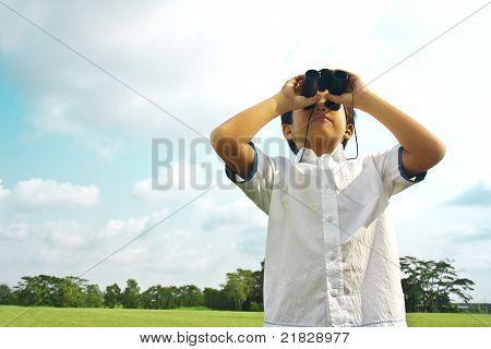 A Boy With Binocular